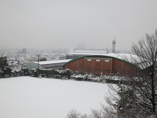 view from above (1), main sport field and main sport building (gym), occupied by snow ... (photo: henri daros)
